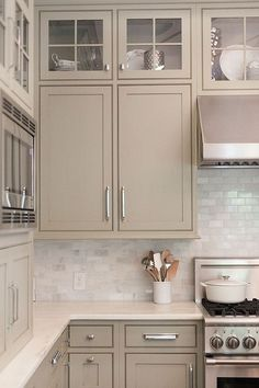 Gray, greige, taupe, and gray greens offer a nice change to the stark white kitchens we've love but have seen over and over – the slightly warmer yet neutral hues feel elegant and refined.