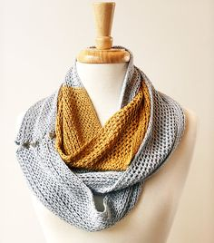 Non commitment infinity scarf! It's a long scarf unless you button the end, then it becomes an infinity scarf!