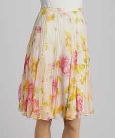 No modern maven's closet collection is complete without a soft flowing skirt. Lightweight and lovely, this floral skirt adds a touch of romance to any ensemble.