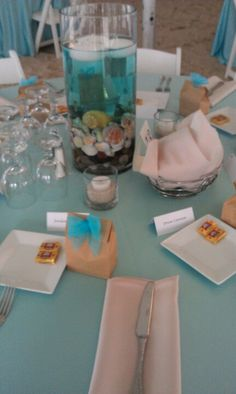 Beach wedding table setting. Definitely could be done buffet style as well.
