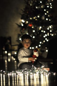 Christmas photo idea. Or have him/her tangled up like they have gotten into the lights