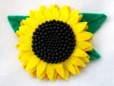 Sunflower brooch made from velt and beads