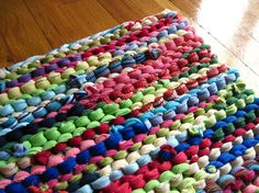 One word in particular suits this t-shirt rug: sprightly. And so spring-like, too, with the pink, cerulean blue, turquoise, and lime color scheme.  http://www.etsy.com/transaction/73431793