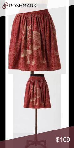 Anthropologie Wooded Hideaway Fox Silk Skirt Anthropologie Corey Lynn Calter Wooded Hideaway Fox Silk Skirt Sz M  Rust and gold fox print skirt from corey lynn calter for anthropologie, size medium.It has a stretchy waist and is a soft flowy material. Has a grass or leaf pattern with foxes hiding in it. Pattern goes all the around the skirt with 2 foxes in front and 2 in back. Gently worn, practically new. 100% SILK. Anthropologie Skirts