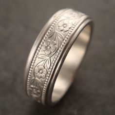 Floral Wedding Band in White Gold by DownToTheWireDesigns on Etsy  This is beautiful and different from any other wedding ring I've seen.
