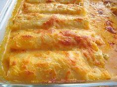 CANELONES DE RAPE Y MERLUZA: En una sartén ponemos un par de cucharadas de aceite de oliva virgen y pochamos el puerro cortado en juliana. Añadimos el pescado cortado en trocitos pequeños. Añadimos una cucharada sopera de tomate frito y rectificamos de sal. Añadimos una cucharada o dos de bechamel.Rellenamos las placas con este preparado y las cubrimos con la bechamel a la que agragamos una cuch. de salsa brava. Espolvoreamos queso y gratinamos.
