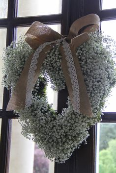 Just behind the Registrars table a heart of Gypsophilia hung on the French Windows