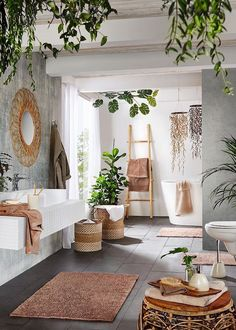 boho Bathroom Decor a contemporary meets boho space with potted greenery, baskets, rattan furniture, a wicker mirror and a ladder Bohemian Bathroom, Bohemian Bedroom Decor, Decor Room, Tropical Bathroom Decor, Green Bathroom Decor, Wooden Bathroom Accessories, Nature Bathroom, Bathroom Modern, Tropical Decor