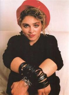 MADONNA!  I would've sold my right arm just to wear those black rubber bracelets (and anklets) on my left arm.