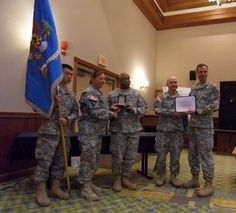 LTC Biggerstaff and Team of 532nd MI accepting the award for the 2013 BN Volunteer of the Quarter from COL Conkright on April 16, 2013