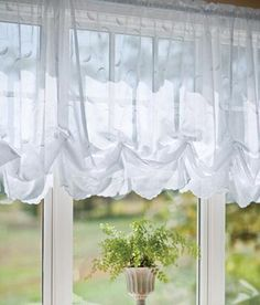 Delicately detailed swirling and curling vines and leaves are embroidered over a gauze-like sheer, finished with a pretty scalloped hem, to create an especially alluring display at your window. (Country Curtains Hathaway Balloon Curtain. Available in White, Cream and Sage.)
