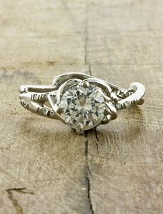 unique engagment rings- not that I need this for a while, but I still love looking at beautiful, yet different rings.