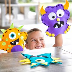 Funny-faced monster puppets. DIY hand puppets are a fun kids craft. This Rawr, Rawr, Rawr! craft kit is only available while supplies last so don't miss out!
