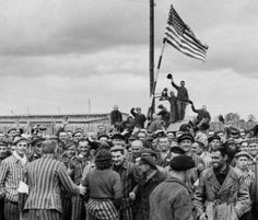 Detainees from Dachau concentration camp gathering on the former place of roll call after the liberation by American soldiers in 1945 Hogans Heroes, American Soldiers, American Flag, World War Ii, Wwii, The Past, Pictures, Photos, Tanks