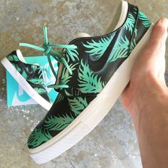 These custom leather Nike SB Zoom Stefan Janoski skate shoes features a sea foam green and gold tropical floral pattern. This order is customizable as I can paint this one-of-a-kind, original design o