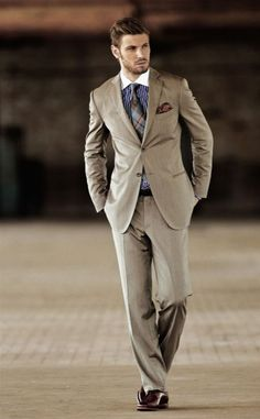 What an awesome suit. Shirt brings the color and tie and pocket square work as balance. Belt could have been more brown than black but it's still a great piece.Check out some other ideas at EverybodyLovesSuits