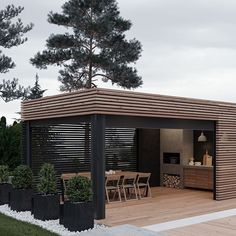 planters with evergreens could be placed in front of deck