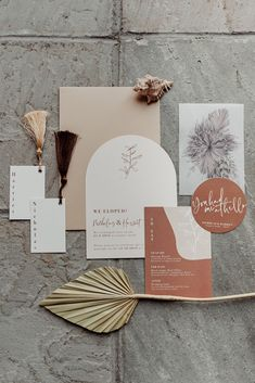 Modern botanical wedding stationery with curved invites and vellum. Placecards with tassels. Dried palms on vellum. Modern boho wedding. Chic wedding stationery. Nude and tan wedding invites with vellum.