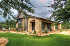 Rustic ranch house retreat designed for family gatherings in Texas | This is the 'party barn'...
