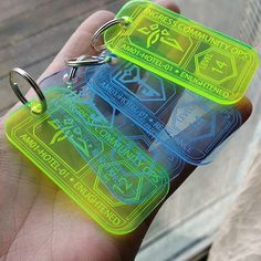 """Nice Ingress keytags. """"These lazer-cut acrylic key chains are designed by me and made for the GPS location-based game, Ingress. They are available in colors neon green or"""