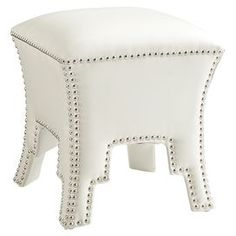 """Tapering ottoman with Moroccan cutouts, a hardwood frame, and nailhead trim.  Product: OttomanConstruction Material: Hardwood and fabricColor: IvoryFeatures: Nailhead trimDimensions: 18"""" H x 16"""" W x 16"""" DCleaning and Care: Wipe clean with a dry cloth"""