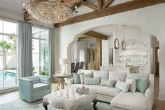Color coordinate colors with accent chair, pillows, rug, curtains  - Jodi Bolgiano Interior Design