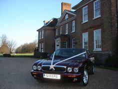Burgundy Jaguar XJ8