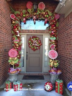 Christmas deco mesh garland and wreath. Created by: Brittani Kelley. How stinking cute is this? Candy Land Christmas, Whimsical Christmas, Christmas Porch, Christmas Themes, Christmas Wreaths, Classy Christmas, Outdoor Christmas Garland, Christmas Topiary, Christmas Crafts
