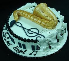 saxophone cake - I should make Carl one of these, birthday coming up.