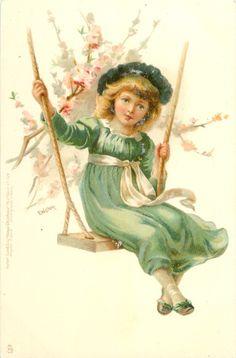 girl in green dress on a swing