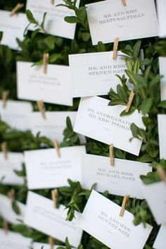 Galleria Marchetti Chicago Wedding: Escort Cards by Cheree Berry Paper tucked into Fresh Boxwood