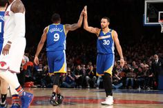 Andre Iguodala and Stephen Curry of the Golden State Warriors high five against the New York Knicks on March 5 2017 at Madison Square Garden in New...