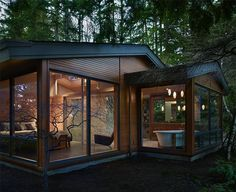 tiny house with lots of windows. I'd be scared to death but i love it!