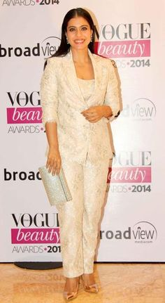 Kajol...why such unflattering pant suit...dull and lifeless colour