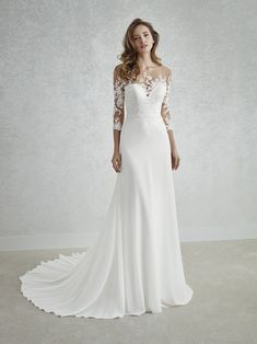 FINURA Magical. This exquisite wedding dress combines a georgette skirt with a spectacular bodice featuring an illusion neckline and back. As with the bodice, the 3/4 sleeves, also in crystal tulle with beaded appliqués, create a second-skin effect. http://www.sanpatrick.com/ro/wedding-dresses/finura-3/4-sleeves.html   FINURA
