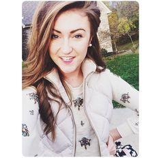 Love her jeweled sweater.