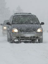 Winter is Coming! Cars driving on snow packed roads during winter storm check the MTO website for tips and information