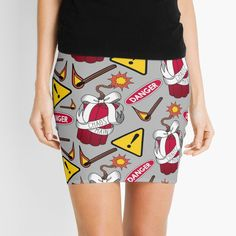 A loud and dangerous-looking miniskirt, sure to grab attention. Perfect for gamer girls, pyromaniacs and rebels who love playing with fire. Features sticks of dynamite, danger and warning signs and lit matches. If you love playing as Junkrat in Overwatch, this is the skirt for you! Gamer Girls, Warning Signs, Overwatch, Best Sellers, Sticks, Red And White, Masks, Mini Skirts, Bows