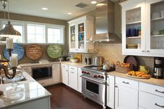 Kitchen, Bath and Closet Cabinetry by Wellborn Cabinet, Inc. Stove and Hood