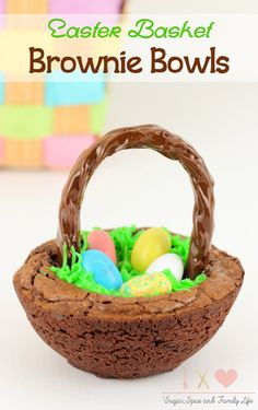 Easter Basket Brownie Bowls are an adorable and delicious Easter dessert. The chocolate brownie bowls are the basket which are filled with green grass icing and mini candy eggs. The basket handle is a piece of chocolate licorice. This chocolate dessert will be a family favorite on Easter. - Easter Basket Brownie Bowls Recipe on Sugar, Spice and Family Life