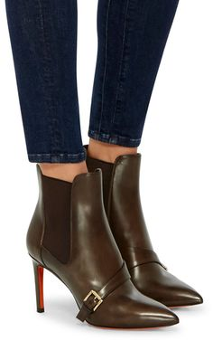 This **Santoni** boots are rendered in a chelsea boot design with a stiletto heel and buckle strap across the vamp.