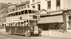 A bus stops outside of the old Moderne store on Patrick Street, Cork c.1960