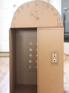 Box Elevator with Push Buttons DIY large (kid-sized) cardboard box elevator with push buttons - so cool! From Repeat Crafter MeDIY large (kid-sized) cardboard box elevator with push buttons - so cool! From Repeat Crafter Me Cardboard Box Crafts, Cardboard Toys, Cardboard Kitchen, Cardboard Box Ideas For Kids, Cardboard Box Houses, Cardboard Playhouse, Diy For Kids, Crafts For Kids, Diy Karton