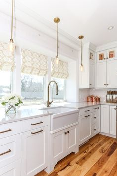 Lewis & Weldon Gorgeous Cape Cod white kitchen with natural hickory details  #kitchenideas #beautifulkitchens #customcabinets #capecod #capecodstyle #whitekitchen #kitchenbacksplash #shakercabinet #whiteshakercabinet #subzerowolf  #hickory #built-in #mixingmetals