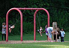 Twins on a swing.