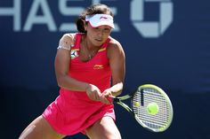 Shuai Peng of China returns a shot against Elena Vesnina of Russia during her women's singles first round match on Day Two of the 2012 US Open