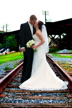 Wedding kiss on the railroad tracks <3