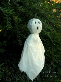 Ball or balloon with white trash bag ghost. Duh? So easy
