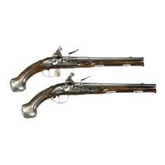 A Pair of English Flintlock Holster Pistols by Andrew Dolep, London, circa 1700