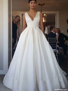 Buy Elegant Straps V Neck Ball Gown Ivory Satin Backless Wedding Dresses with Pockets in uk.Shop our beautiful collection of unique and convertible long Prom dresses from PromDress.uk,offers long bridesmaid dresses for women in the UK. Preppy Wedding Dress, How To Dress For A Wedding, Wedding Dress With Pockets, Wedding Dress Necklines, V Neck Wedding Dress, Backless Wedding, Ivory Wedding, Tulle Wedding, Mermaid Wedding